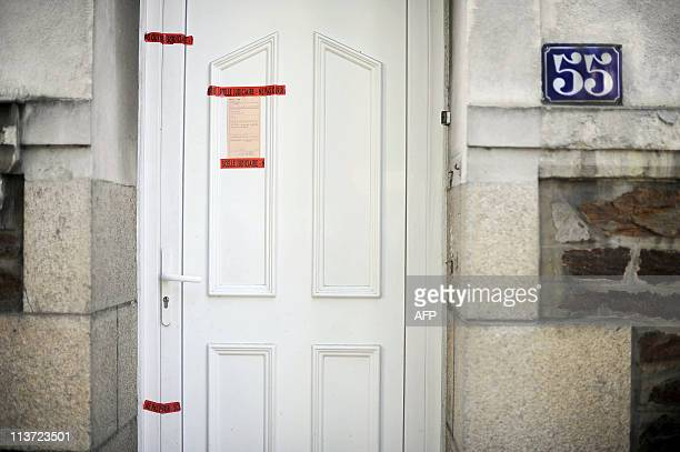A picture taken on April 23 2011 in the French western city of Nantes shows a police seal on the frontdoor of Dupont de Ligonnes' family home French...