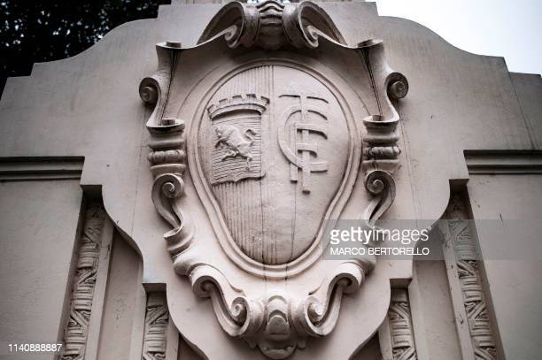 A picture taken on April 23 2019 shows the emblem of the Torino FC on the 'Filadelfia' the stadium of Grande Torino now head stadium of the young...
