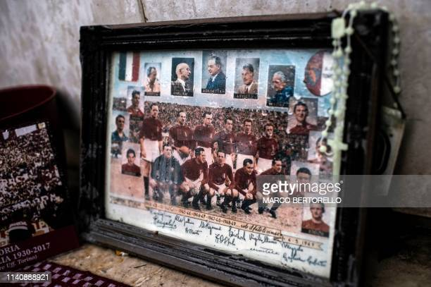 Picture taken on April 23, 2019 shows the picture of the team of Grande Torino on the monument build to remember the tragedy crash of the plane of...