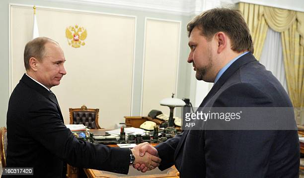 A picture taken on April 23 shows Russia's President then Prime Minister Vladimir Putin meeting Nikita Belykh the liberalleaning governor of the...
