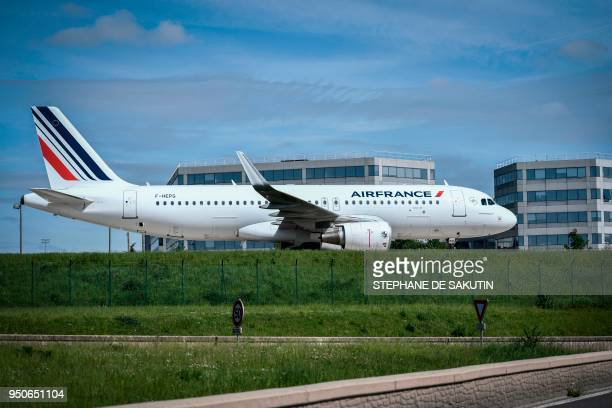 A picture taken on April 24 2018 shows a Air France plane parked on the tarmac of RoissyCharles de Gaulle Airport northern Paris Air France staff...