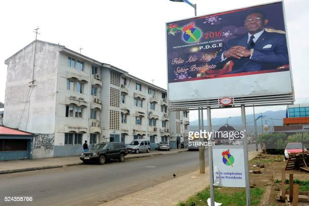 Picture taken on April 25, 2016 shows an electoral poster of incumbent Equatorial Guinea's president Teodoro Obiang Nguema from the Democratic Party...