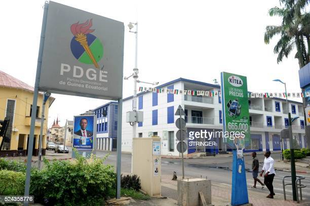 A picture taken on April 25 2016 shows an electoral poster of incumbent Equatorial Guinea's president Teodoro Obiang Nguema from the Democratic Party...