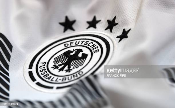 A picture taken on April 25 2018 in Paris shows the jersey of the German national football team for the FIFA 2018 World Cup football tournament