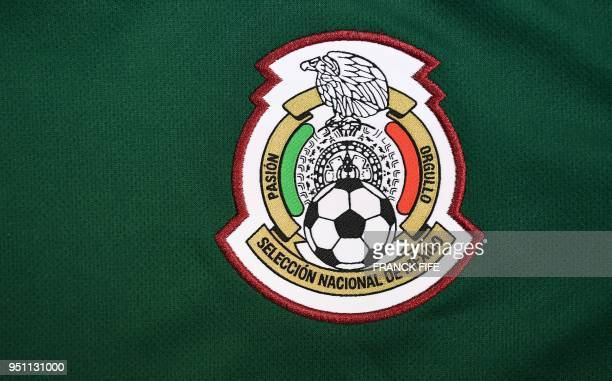 Picture taken on April 25, 2018 in Paris, shows the jersey of the Mexican national football team for the FIFA 2018 World Cup football tournament.