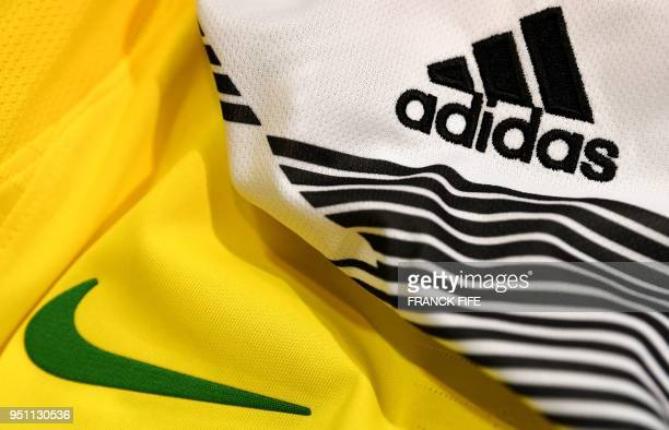 Picture taken on April 25, 2018 in Paris, shows the logo of sports wear manufacturers Nike and Adidas for the FIFA 2018 World Cup football tournament.