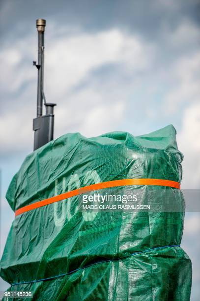 A picture taken on April 25 2018 shows a detail of the homemade submarine UC3 Nautilus as it is covered with green tarpaulin in Nordhavn a harbour...