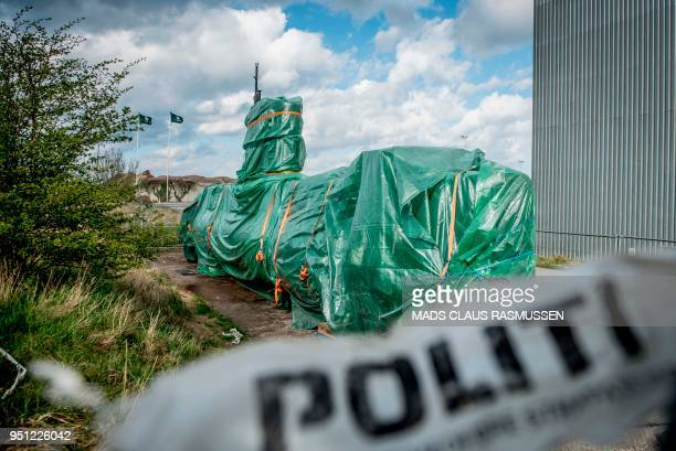 A picture taken on April 25 2018 shows the homemade submarine UC3 Nautilus as it is covered with green tarpaulin in Nordhavn a harbour area in...