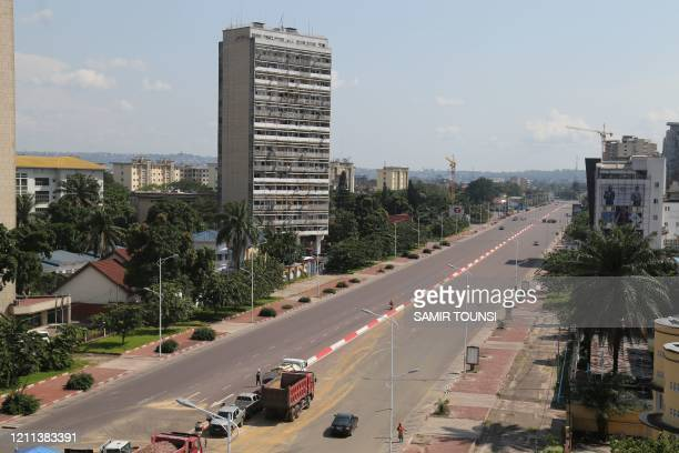 Picture taken on April 25, 2020 shows the completely deserted Boulevard du 30-Juin in the residential commune of Gombe in Kinshasa in the Democratic...