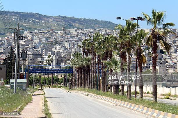 A picture taken on April 25 shows the eastern entrance of the northern Syrian town of Jisr alShughur AlQaeda's Syrian affiliate and other Islamist...