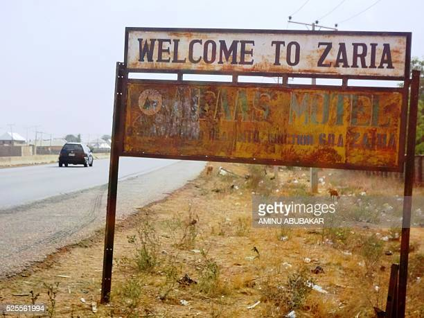 A picture taken on April 26 2016 shows a vehicle driving past sign post outside the northern Nigerian city of Zaria where around 350 members of the...
