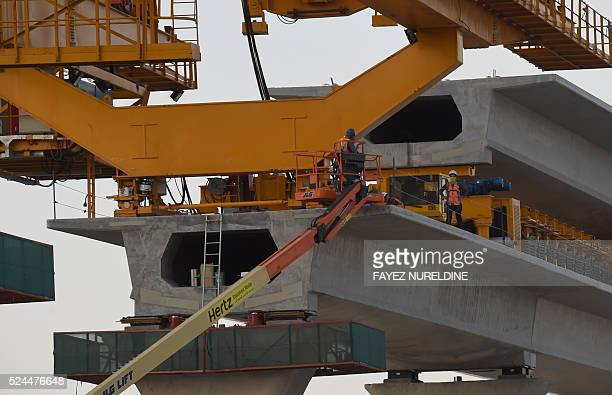 A picture taken on April 26 2016 shows workers at a construction site of a section of the Saudi capital Riyadh's $225 billion metro system The system...