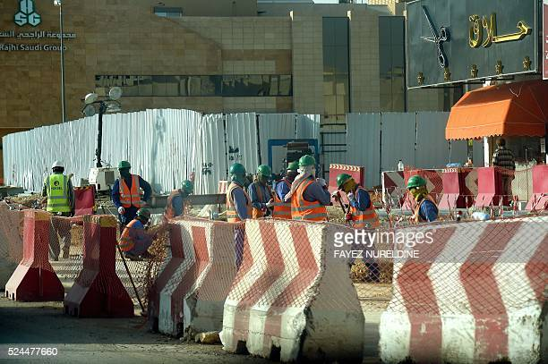 A picture taken on April 26 2016 shows workers at a construction site of a new street in the Saudi capital Riyadh Deputy Crown Prince Mohammed bin...