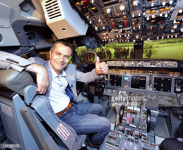 A picture taken on April 28 2011 shows Chief Executive Office of Corendon Dutch Airlines Atilay Uslu posing in the cockpit of a Boeing 737 at...