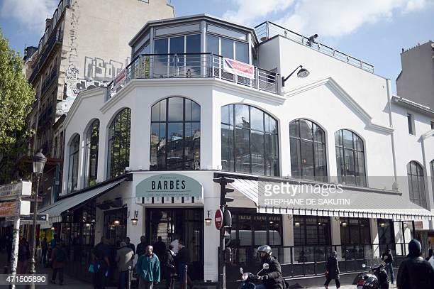 A picture taken on April 28 2015 shows the new Brasserie Barbes in northern Paris The trendy fourlevel brasserie opens its doors on April 30 a symbol...