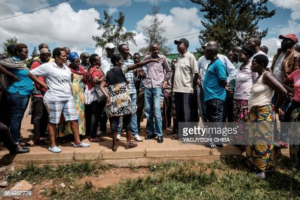 A picture taken on April 28 2018 shows 33yearold woman explaining where was a pit which was used as a mass grave during 1994 Rwandan genocide in...