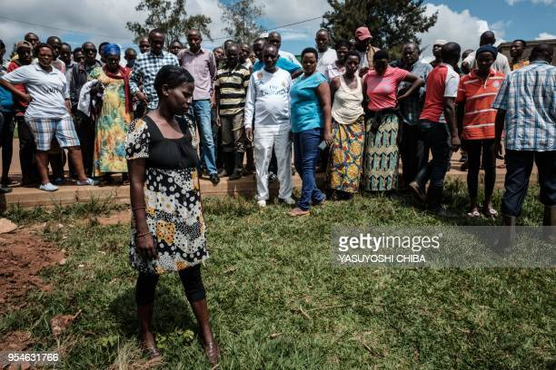 A picture taken on April 28 2018 shows a 33yearold woman explaining the location of a pit which was used as a mass grave during 1994 Rwandan genocide...