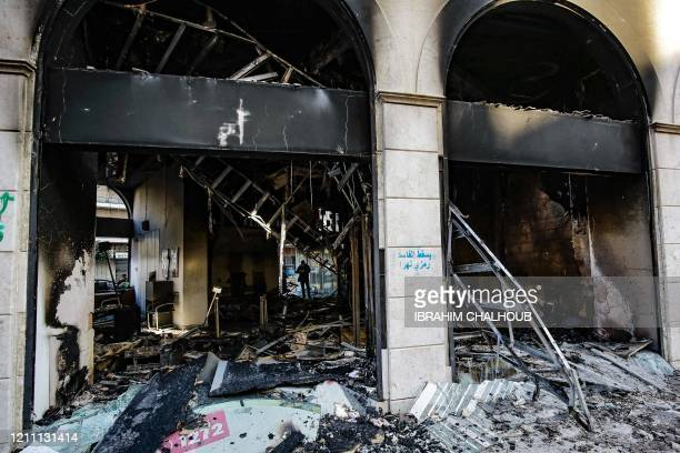 Picture taken on April 28, 2020 shows the aftermath of a bank set ablaze overnight by some protesters following a demonstration over the country's...