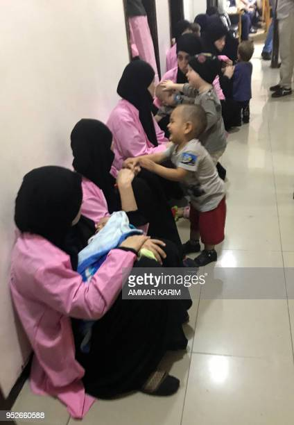 A picture taken on April 29 2018 in the Iraqi capital Baghdad's Central Criminal Court shows Russian women who have been sentenced to life in prison...