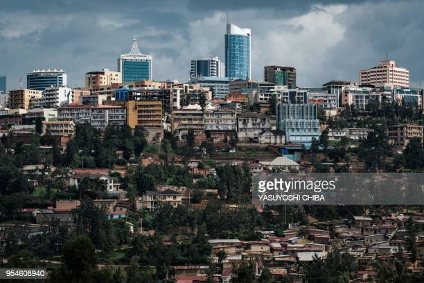 A picture taken on April 29 2018 shows a view of city center from the Kigali Genocide Memorial in Kigali Rwanda According to the main association of...