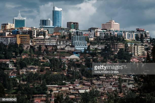 Picture taken on April 29, 2018 shows a view of city center from the Kigali Genocide Memorial in Kigali, Rwanda. - According to the main association...