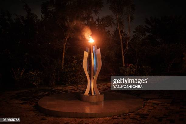 A picture taken on April 29 2018 shows the flame of Remembrance at the Kigali Genocide Memorial in Kigali Rwanda According to the main association of...