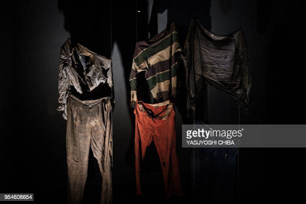 A picture taken on April 29 2018 shows victims' clothes at the Kigali Genocide Memorial in Kigali Rwanda According to the main association of the...