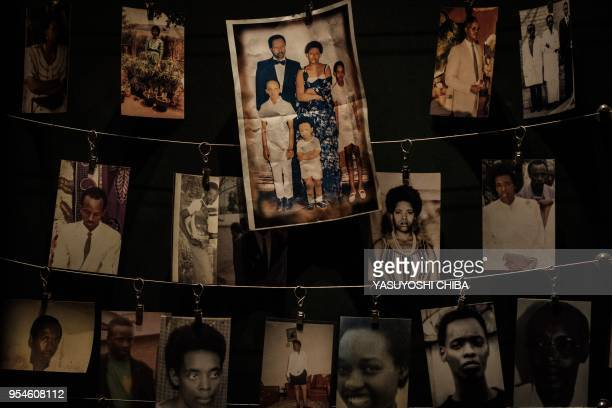 A picture taken on April 29 2018 shows victims' portraits displayed during an exhibition at the Kigali Genocide Memorial in Kigali Rwanda According...
