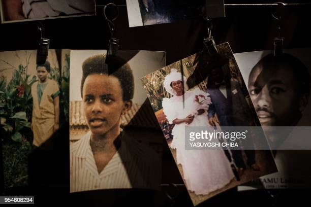 A picture taken on April 29 2018 shows victims' portraits displayed at the Kigali Genocide Memorial in Kigali Rwanda According to the main...