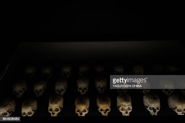 A picture taken on April 29 2018 shows victims' skulls at the Kigali Genocide Memorial in Kigali Rwanda According to the main association of the...