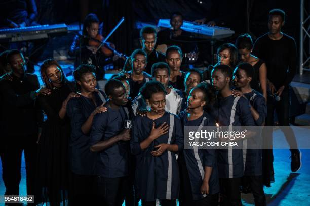 A picture taken on April 29 2018 shows young actors of Shekinah Drama Team of Evangelical Restoration Church performing the scene of genocide from...