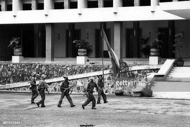 A picture taken on April 30 1975 in Saigon shows North Vietnamese Army forces taking over the South Vietnamese presidential palace South Vietnamese...