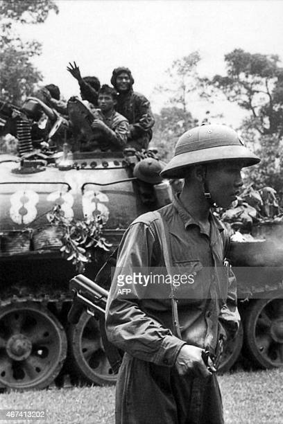 A picture taken on April 30 1975 in Saigon shows tanks of the North Vietnamese Army forces taking over the South Vietnamese presidential palace South...