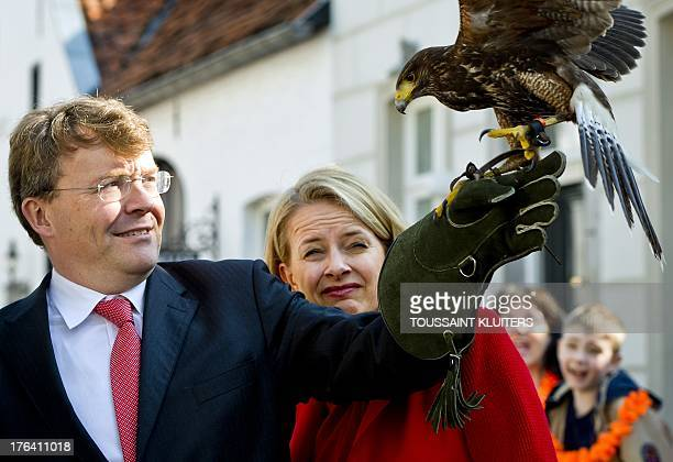 A picture taken on April 30 2011 shows Dutch Prince Johan Friso holding a desert hawk during Queen's day in Thorn Prince Friso younger brother of...