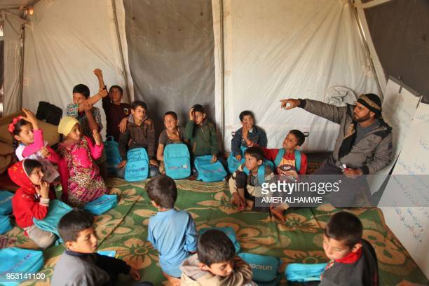 TOPSHOT A picture taken on April 30 2018 in a camp for displaced Syrians from villages and towns around Abu Duhur on the eastern edge of Idlib...