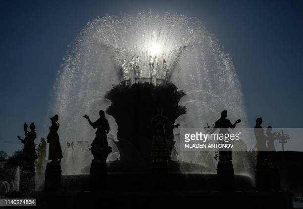 A picture taken on April 30 2019 shows the Friendship of Nations fountain at VDNKh on the day of its reopening following restoration in Moscow The...