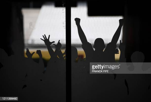 """Picture taken on April 30, 2020 shows decorations dpicting fans in a field access tunnel of the """"Stade de France"""" in Saint-Denis, north of Paris on..."""
