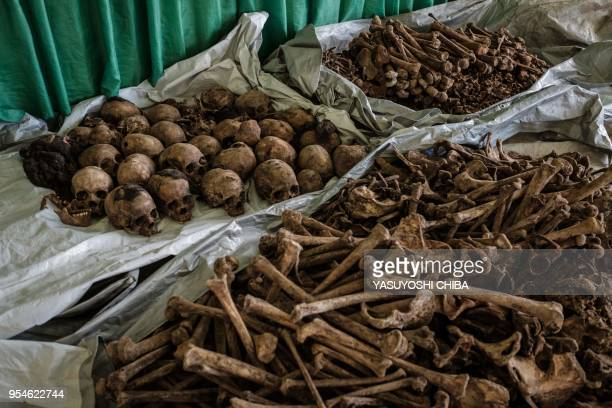 A picture taken on April 30 shows collected victims' bones and skulls from a newly discovered pit which was used as mass grave during 1994 Rwandan...