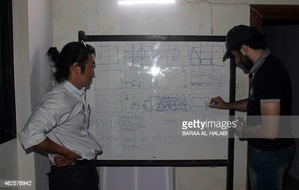 A picture taken on April 30 shows Japanese journalist Kenji Goto leading a training seminar for Syrian journalists in the northern Syrian city of...