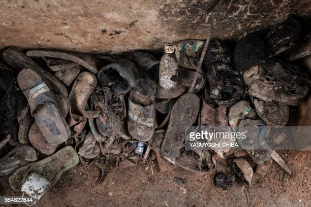 A picture taken on April 30 shows victims' items collected from a pit which was used as mass grave during 1994 Rwandan genocide and hidden under a...