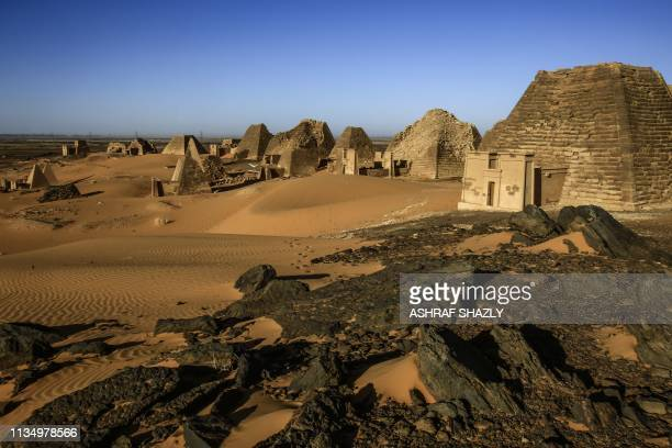 TOPSHOT A picture taken on April 4 2019 shows a partial view of the Meroe pyramids which hold burial chambers for Kushite kings and queens whose rule...
