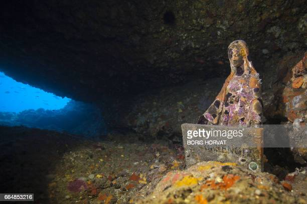 A picture taken on April 5 2017 in the sea off La Ciotat southern France shows a Virgin Mary statue known as Gaby's Virgin A Virgin Mary statue known...