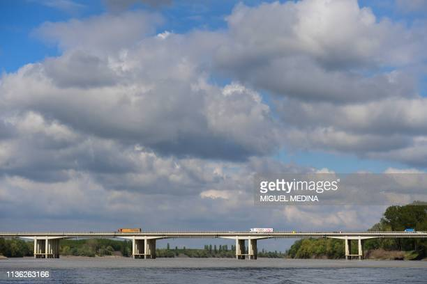 A picture taken on April 5 2019 from the Po river the longest river in Italy shows the Ponte Autostrada Brennero close to Motteggiana The Po Valley...