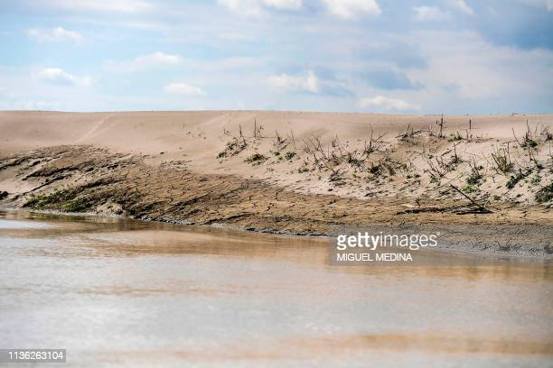 A picture taken on April 5 2019 shows the Po river the longest river in Italy close to Motteggiana and the Ponte Autostrada Brennero The Po Valley is...