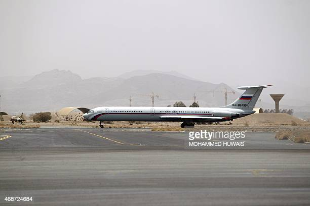 A picture taken on April 6 2015 shows an aircraft of the Russian Federation Air Force stationned on the tarmac of Sanaa International Airport as...