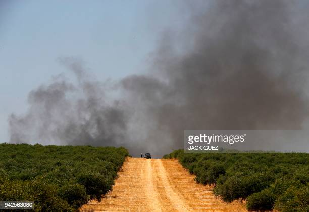 A picture taken on April 6 near the southern Israeli kibbutz of Nahal Oz shows tire burning smokes during a protest at the border with the Gaza strip...