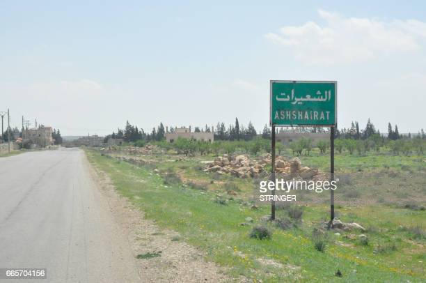 A picture taken on April 7 2017 shows a sign with the name of the village of Shayrat at its entrance near the Syrian government forces military base...
