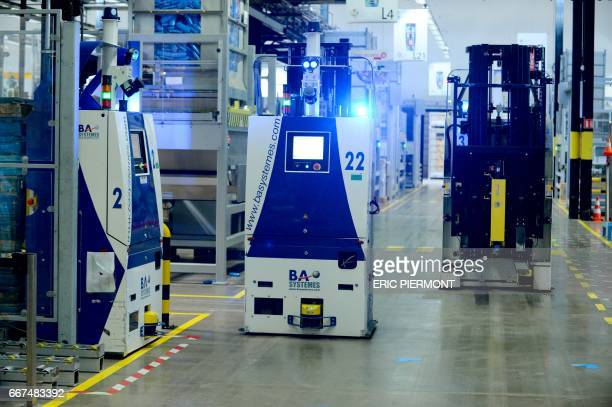 A picture taken on April 7 2017 shows an automated Guided Vehicles AGVs operating at French cosmetics giant L'Oreal factory in Rambouillet near Paris