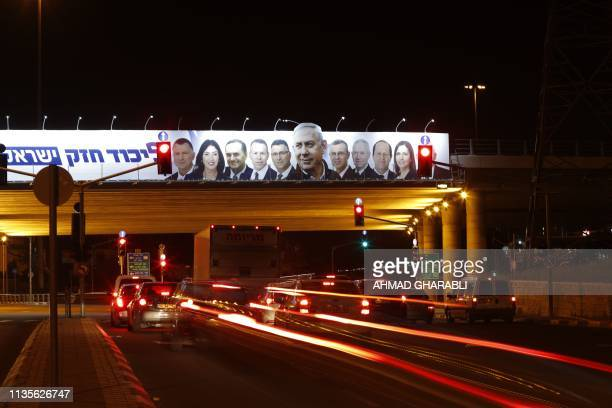 A picture taken on April 7 2019 shows a Likud party electoral billboard for Israel's upcoming general elections bearing the portrait of Prime...
