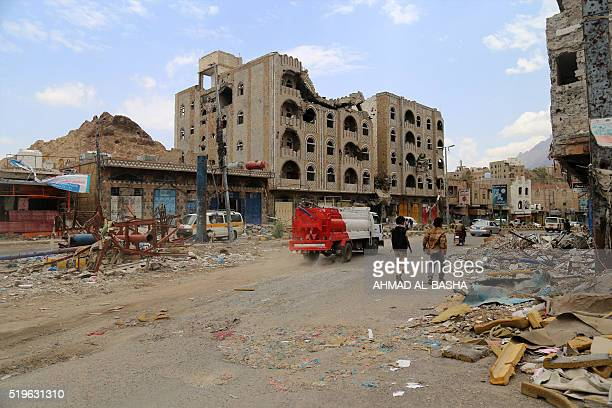 Picture taken on April 7 shows heavily damaged buildings on a street in Yemen's third city Taez as a result of clashes between Shiite Huthi rebels...
